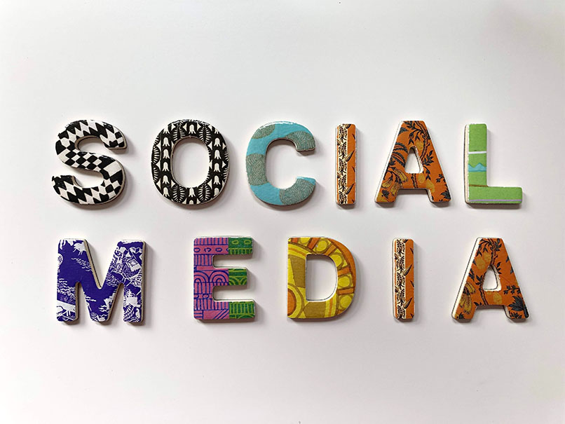 Chipboard letters spelling out social media