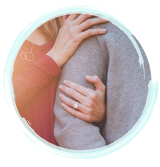 Zoomed in image of a woman holding onto a man's arm | Couples Therapy In Fort Myers, Marriage Counseling In Fort Myers, Marriage Counselors In Fort Myers