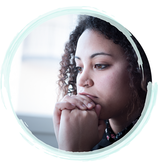 Image of a young woman resting her head in her hands looking discouraged | Fort Myers Trauma and EMDR Therapy & Fort Lauderdale Trauma and EMDR Therapy Services by A Peaceful Mind Counseling Group