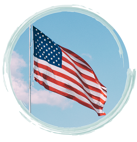 Image of an American flag against the sky | Fort Myers Veteran & First Responder Therapy and Fort Lauderdale Veteran & First Responder Therapy Services by A Peaceful Mind Counseling Group